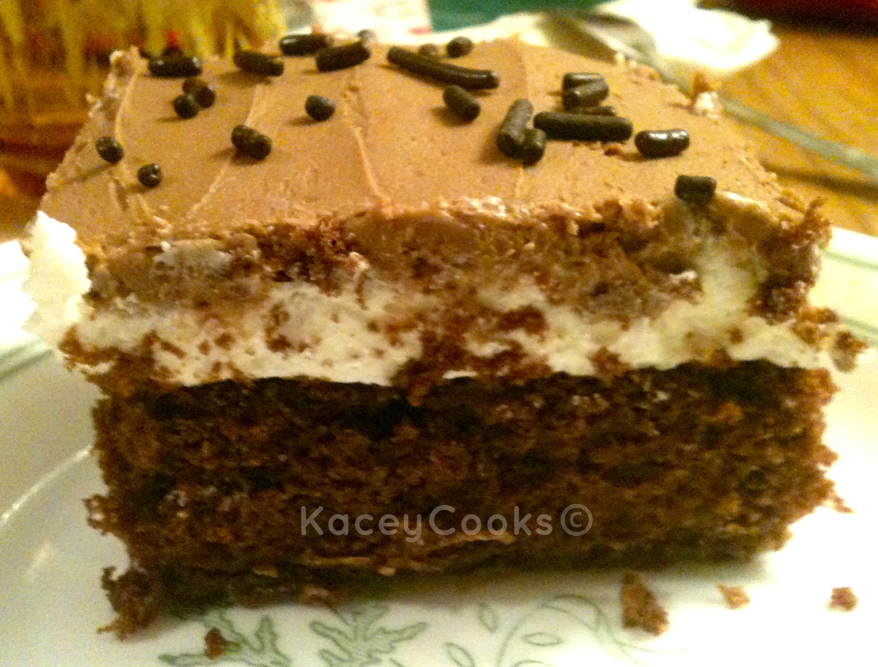 Tastes just like the Hostess snack cake- it's Ho-Ho cake. My version is organic and GMO-Free! Chocolate cake with a creamy white filling and a yummy chcolate icing tops off the best midnight snack you'll ever have! #Real Food Girl: Unmodified